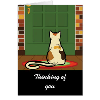 Cat sitting in front of a green door card