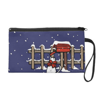 Cat sitting near a mailbox in snowfall wristlet