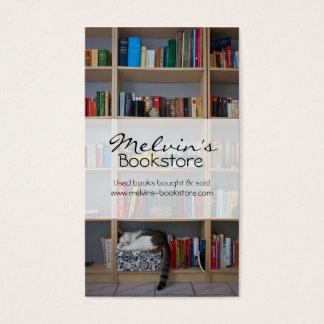 Cat sleeping in bookshelf library books business card
