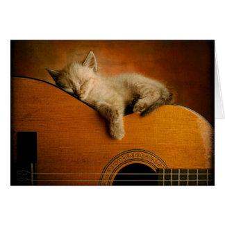 Cat sleeping on guitar greeting card