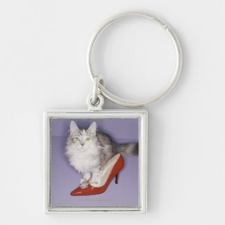 Cat stepping into high heel keychain