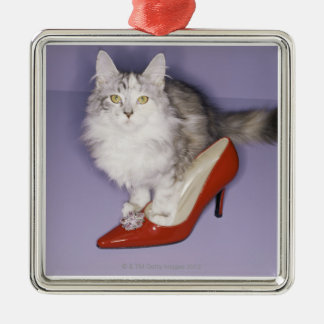 Cat stepping into high heel christmas tree ornaments