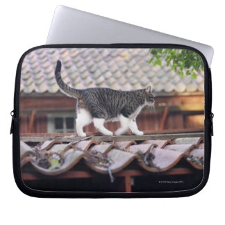 Cat walking on roof of shed computer sleeve