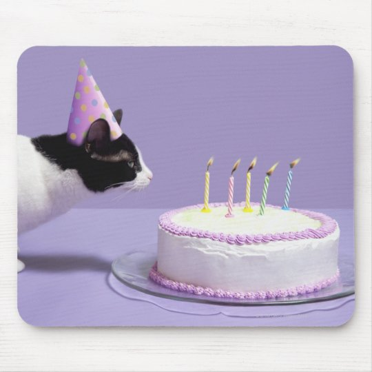 Cat wearing birthday hat blowing out candles mouse pad
