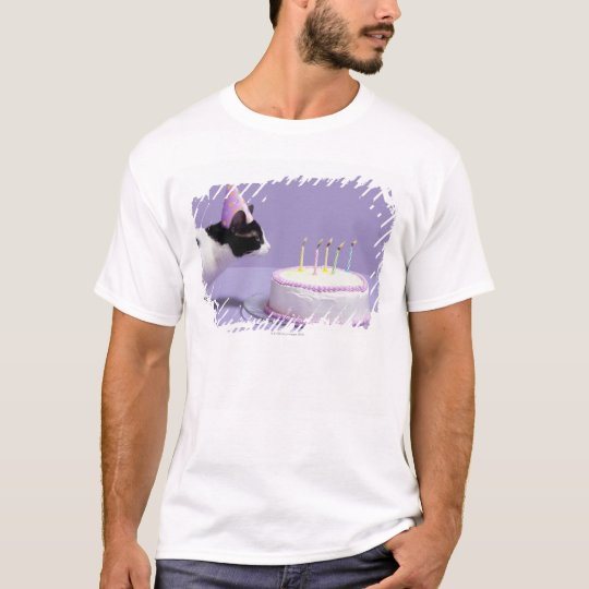 Cat wearing birthday hat blowing out candles on T-Shirt