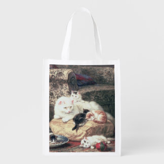 Cat with her Kittens on a Cushion Grocery Bag