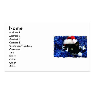 Cat with santa hat looking out from blue tinsel business card template