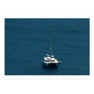Catamaran moored offshore postcard