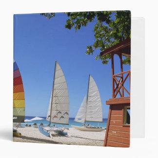 Catamarans And Lifeguard Stand On Beach Binder