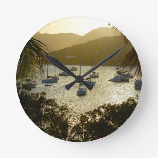 Catamarans and sailboats round clock