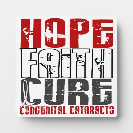 Cataratas congénitas de la curación de fe de la es placa de madera