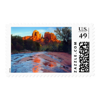 Cathedral Rock reflecting in Oak Creek at Sunset Postage Stamp