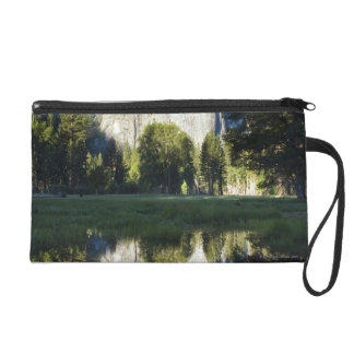 Cathedral Rocks are reflected in a pool of water Wristlet Purse