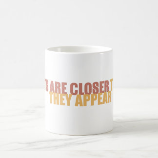 Cats are closer than they appear coffee mug