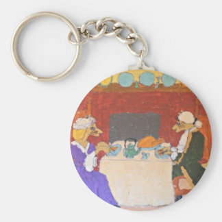 Cats dining on a holiday keychain