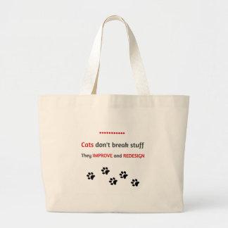 Cats don't break stuff large tote bag