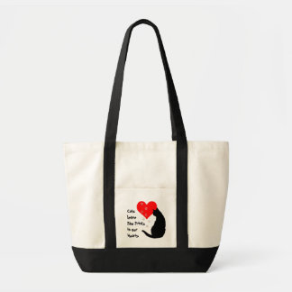 Cats leave paw-prints in our hearts tote bag