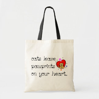Cats leave pawprints on your heart. budget tote bag