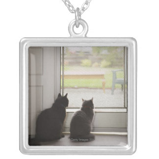 Cats looking out screen door silver plated necklace