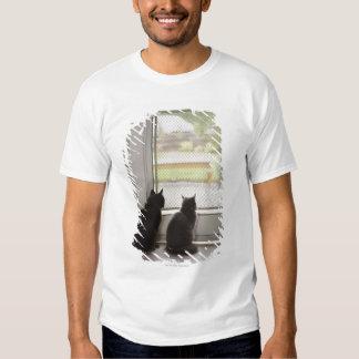 Cats looking out screen door t-shirt
