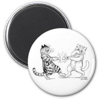 Cats Pulling Cracker Magnet