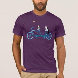 Cats riding a bike chasing a bird T-Shirt