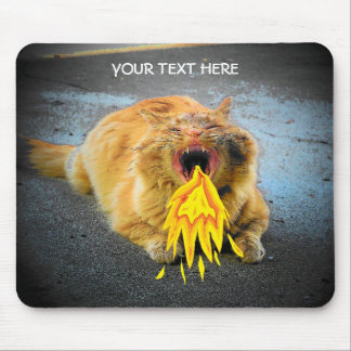 Catzilla has fire breath! mousepads