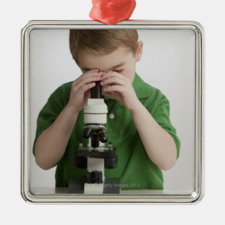 Caucasian boy peering into microscope metal ornament