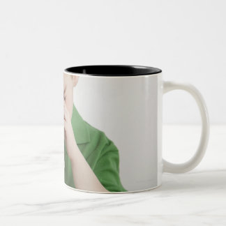 Caucasian boy peering into microscope Two-Tone coffee mug