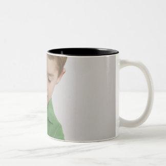 Caucasian boy using microscope Two-Tone coffee mug