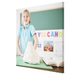 Caucasian girl standing with model volcano canvas print