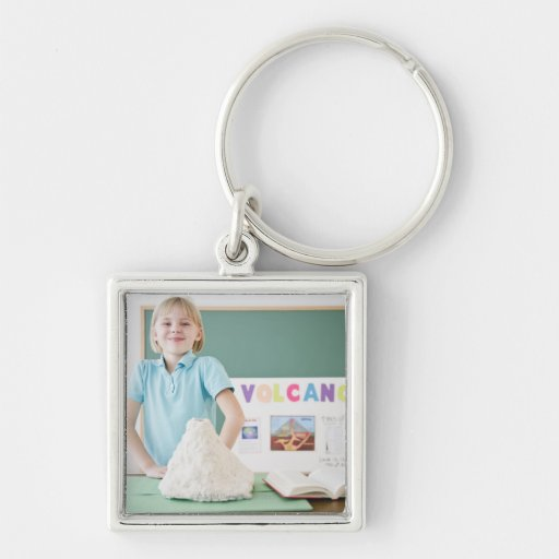 Caucasian girl standing with model volcano Silver-Colored square keychain