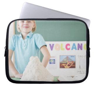Caucasian girl standing with model volcano laptop sleeve