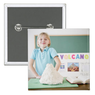 Caucasian girl standing with model volcano pinback button