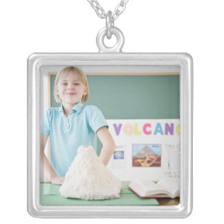 Caucasian girl standing with model volcano silver plated necklace