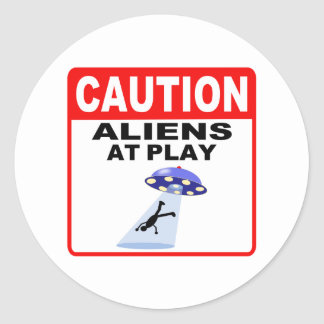 Caution Aliens At Play (Black Text) Round Stickers
