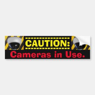 CAUTION: Cameras in Use. Theft Deterrent Bumper Sticker