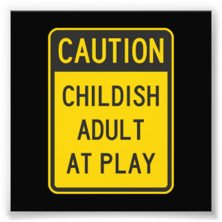 Caution Childish Adult at Play Photo Print