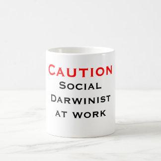 Caution Social Darwinist at work Coffee Mug