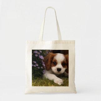 Cavalier King Charles Spaniel Puppy behind flowers Tote Bag