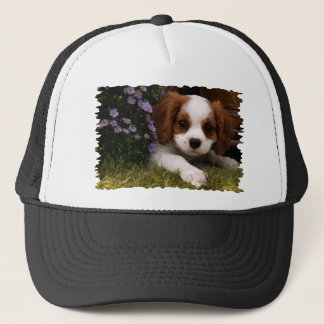 Cavalier King Charles Spaniel Puppy behind flowers Trucker Hat