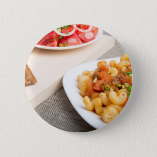 Cavatappi Pasta with sauce of stewed vegetables Button