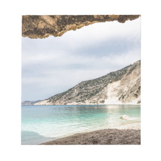 Cave outlook on sea mountain and beach notepad
