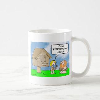 Cavewoman builds pterodactyl house coffee mug