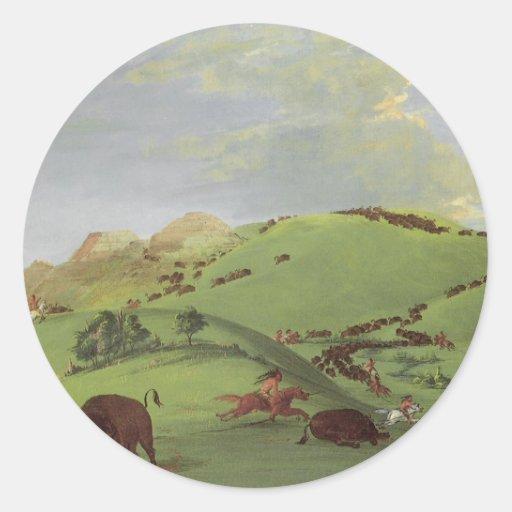 Caza del búfalo por Catlin, nativos americanos del Pegatina Redonda