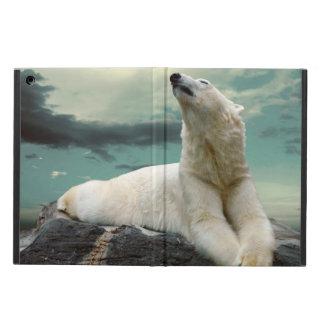 Cazador blanco del oso polar en roca
