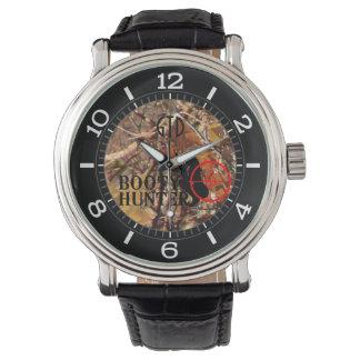 Cazador del botín en el dial del camuflaje de la reloj