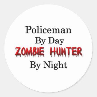 Cazador del policía/del zombi pegatina redonda
