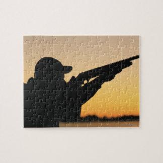 Cazador y arma puzzle con fotos