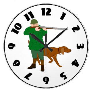 Cazador y un reloj del perro